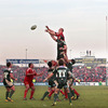 Paul O'Connell rises high to claim a lineout ball for Munster, ahead of London Irish's Nick Kennedy