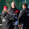 Paul O'Connell talks tactics with Munster forwards coach Laurie Fisher and his second row colleague Mick O'Driscoll