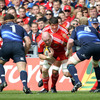Leinster's Heinke van der Merwe and Leo Cullen lie in wait as Munster skipper Paul O'Connell charges towards them