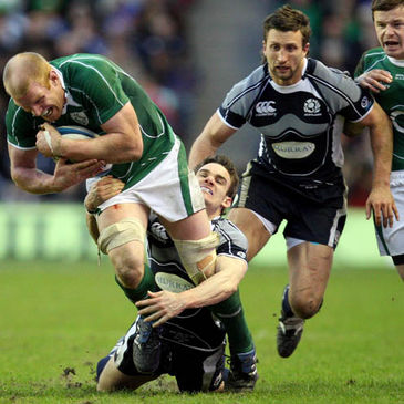 Paul O'Connell is tackled by Scotland centre Max Evans