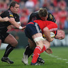 Munster skipper Paul O'Connell is challenged by Ospreys front row duo Paul James and Richard Hibbard