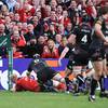 The Thomond Park faithful erupt as Paul O'Connell dives over to score in the right corner