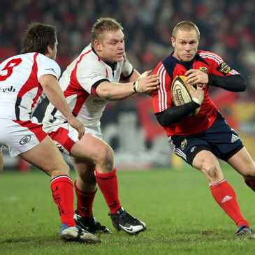 Munster full-back Paul Warwick takes on Ulster's Isaac Boss and Tom Court