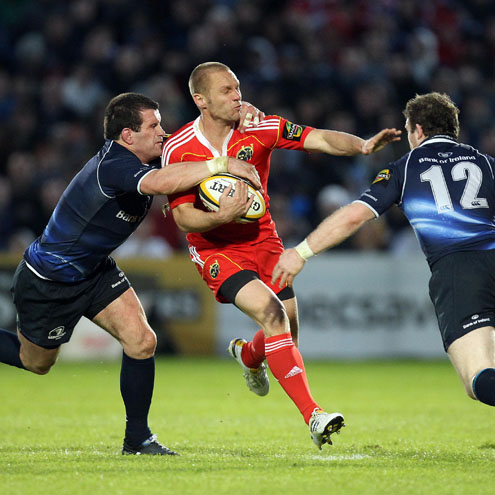 Munster's Paul Warwick on the attack against Leinster