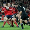 Back to the action and Paul Warwick looks for support as Munster try to break through the All Blacks' defence