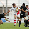 Ulster flanker Pedrie Wannenburg fends off Aironi's Italian international prop Salvatore Perugini