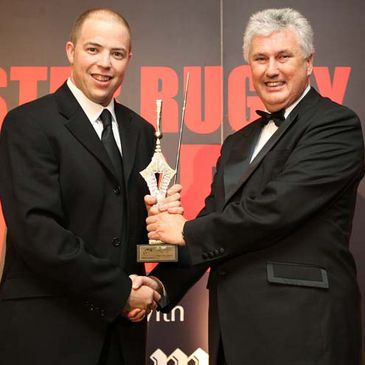 Peter Fitzgibbon receives his Munster Rugby Referee of the Year award from Gerry O'Loughlin