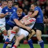 Ulster full-back Peter Nelson keeps a tight hold of possession as he is wrapped up by Leinster's Darragh Fanning and Jimmy Gopperth