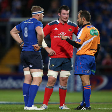 Peter O'Mahony with Jamie Heaslip and referee Romain Poite