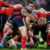 Munster scrum half Peter Stringer is caught, off the back of a scrum, by his opposite number Jason Spice