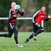 Scrum half Peter Stringer collects a pass at training, with centre Kieran Lewis in support
