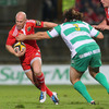 As Munster build another attack, scrum half Peter Stringer tries to break past Benetton Treviso's Ignacio Fernandez-Rouyet