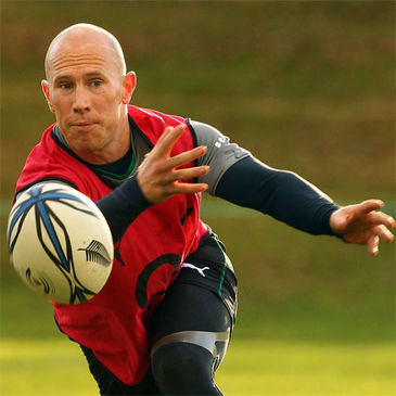 Peter Stringer spins a pass away at training