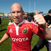 Peter Stringer celebrates Munster's qualification for the Amlin Challenge Cup semi-finals. They will host Harlequins in the last four