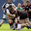 Edinburgh out-half Phil Godman has nowhere to go as Leinster's Brian O'Driscoll and Felipe Contepomi wrap him up
