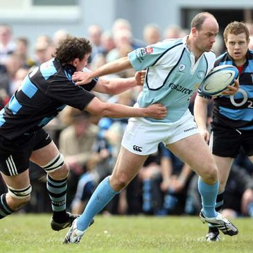 Shannon's Phil O'Connor tackles Garryowen full-back Conor Kilroy