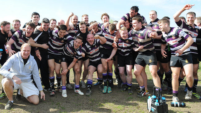 The Terenure College players and coaches celebrate