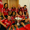 Departing centre Kieran Lewis grips the Magners League trophy alongside some of his Munster team-mates