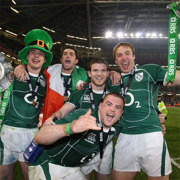 The Ireland players celebrate at the Millennium Stadium