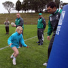 Rob Kearney urges a young girl on as she runs towards a tackle bag during Friday's coaching clinic in New Plymouth