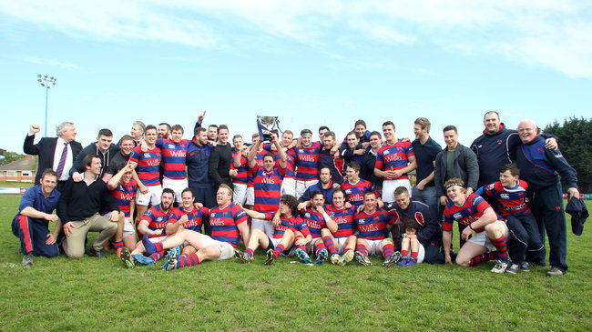 The Clontarf players and coaches celebrate