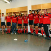 A soaked Jerry Flannery joins his team-mates in song, just days before he and five other Munster players link up with the Lions