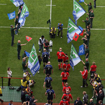 The Leinster and Munster teams walk out at Croke Park
