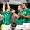 As Jonathan Sexton completes the scoring with a fine conversion from near the left touchline, Gordon D'Arcy and the rest of the players celebrate Ireland's qualification for the quarter-finals