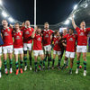 The players celebrate together with the travelling fans after securing the Lions' first Test series win since 1997