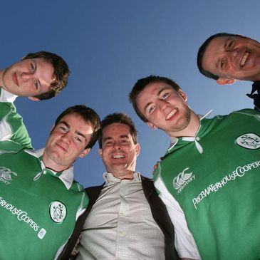 PwC's Feargal O'Rourke with coach Charlie McAleese and some members of the Irish squad