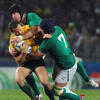 Quade Cooper is caught in possession by flankers Stephen Ferris and Sean O'Brien as the rain falls in Auckland