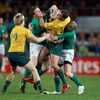 The attacking threat posed by Wallaby playmaker Quade Cooper was nullified by Ireland's strong tackling - Brian O'Driscoll and Keith Earls are pictured swarming over him