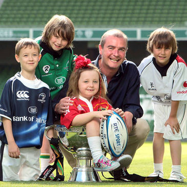 Daire O'Brien and the kids pose with the Magners League trophy