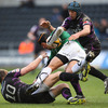 Connacht flanker Ray Ofisa gets airborne as he is tackled by the Ospreys' Dan Biggar and Justin Tipuric