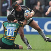 Joe Ansbro, one of Northampton's try scorers, tries to bring Ray Ofisa to ground at Franklin's Gardens