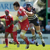 Munster flanker David Wallace is challenged by Brive's Retief Uys during the opening minutes of the game