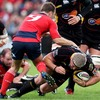 Dragons prop Rhys Thomas goes to ground under pressure from Munster's Tomas O'Leary