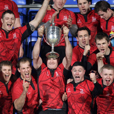 Old Belvedere's Richie Leyden lifts the trophy at Donnybrook