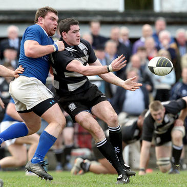Old Belvedere's Richie Leyden offloads the ball
