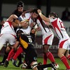 Dragons number 8 Grant Webb is outnumbered as Ulster's Rob Dewey tries to set up an attack