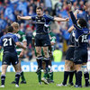 Brian O'Driscoll jumps for joy as the Leinster players start the celebrations of their Heineken Cup win