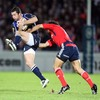 Rob Kearney, on as a replacement for Leinster, is caught by a tackle from Munster's try-scoring winger Doug Howlett