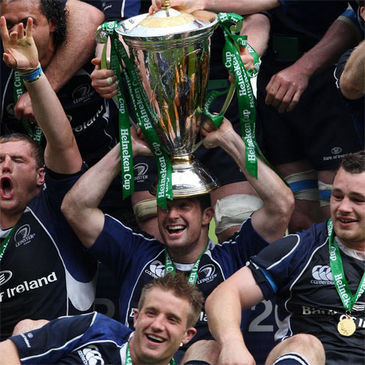 Rob Kearney balances the trophy on his head as Leinster celebrate their Heineken Cup success