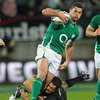 Ireland full-back Rob Kearney tries to slip out of a tackle from the All Blacks' Dan Carter who pushed through the 1000-point barrier on Saturday