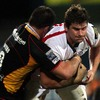Ulster number 8 Robbie Diack carries the ball into contact against the Dragons' Grant Webb, who previously played for the province