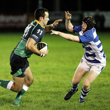 Ballynahinch winger Robin Harte takes on Dungannon's Peter Nelson