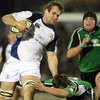 Connacht's Ian Keatley makes a last-gasp tackle on Rocky Elsom as the Leinster flanker bounds towards the try-line