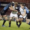 Leinster flanker Rocky Elsom tries to wrestle free of Kelly Brown's grasp as Andrew Henderson closes in