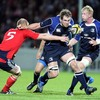 Leinster's new flanker Rocky Elsom tries to hand off Munster captain Paul O'Connell