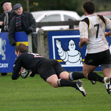 Roger McBurney dives over for a try against Young Munster